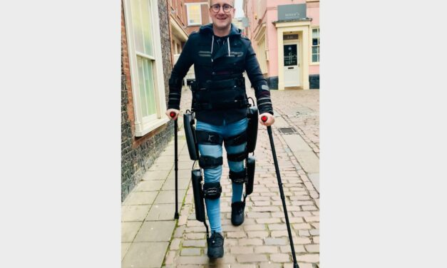 Simon's fundraising walk for hospital charity in exoskeleton suit